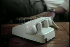 Close-up of man rushing to pick up telephone receiver Stock Footage