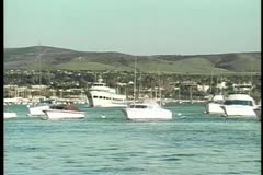 Wide shot of boats in harbor Stock Footage