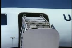 Aircraft boarding staircase folding into airplane Stock Footage