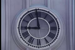 Close-up of minute hand on wall clock moving to 9 o'clock Stock Footage