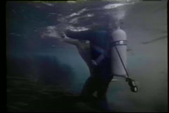 Scuba diver rescuing girl drowning in coral reef Stock Footage
