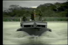 Soldiers in boat bombing and shooting underwater scuba diver Stock Footage