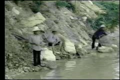 Asian fishermen casting a net in river Stock Footage