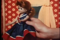 Close-up of girl's hand playing with doll in dollhouse Stock Footage