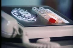 Close-up of landline phone with buttons blinking - stock footage