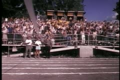 Wide shot of crowd applauding from bleachers - stock footage