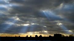 Sunrays break clouds city Stock Footage