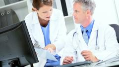 Stock Video Footage of Medical Colleagues Meeting on Patient Test Results