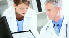 Hospital Medical Consultants Working Wireless Tablet Stock Footage