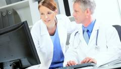 Medical Staff Making Patient Care Plans Stock Footage