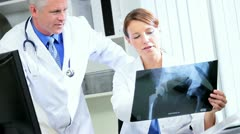 Medical Consultants Looking X-Ray Results Stock Footage