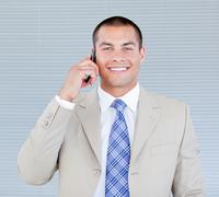 Self-assured businessman talking on phone - stock photo
