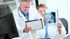 Radiologist Examining X-Ray Film - stock footage