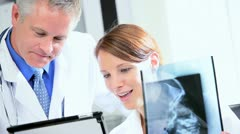 Hospital Doctors Using X-Ray with Wireless Tablet Stock Footage