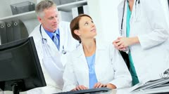 Hospital Medical Consultants Working Care Plans - stock footage