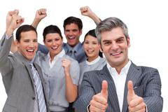 Self-assured business team looking at the camera - stock photo