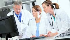 Doctors Using Patient Clinical Computer Data Stock Footage