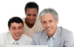 Business people working at a computer Stock Photos