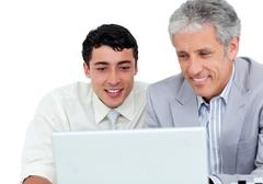 Stock Photo of Assertive business co-workers using a laptop