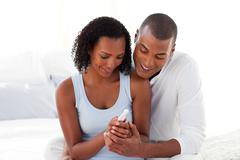 Happy couple finding out results of a pregnancy test - stock photo