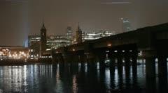 Boat under bridge on River Thames Night Stock Footage