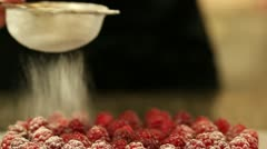 Sugaring raspberry tart Stock Footage