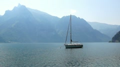 Yacht on the Lake on a background of mountains - stock footage