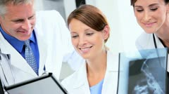 Medical Consultants Looking X-Ray Results Close up - stock footage
