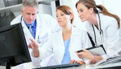 Medical Consultants Planning Patient Treatment - stock footage