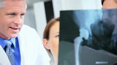 Caucasian Doctors Checking X- Ray Film Stock Footage