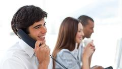 Assertive businessman talking on phone Stock Photos