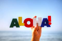Female's hand holding colorful word 'aloha' Stock Photos