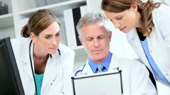 Doctors Using Clinical Tablet Data - stock footage