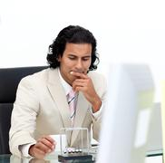 Close-up of serious businessman playing with kinetic balls Stock Photos