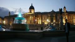 Trafalgar square fountain London at night Stock Footage