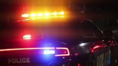 Police Car with Flashing Lights Parked at a DUI Sobriety Checkpoint at Night Stock Footage