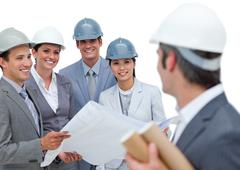 Self-assured architect team talking together - stock photo