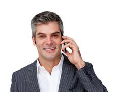 Self assured businessman talking on phone - stock photo