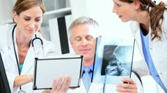 Medical Clinicians Looking X-Ray Results - stock footage