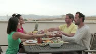 Group of friends praying together at the table HD Stock Footage