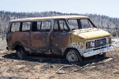 Vehicle destroyed by wildfire in mountain 0908 - stock photo