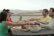 Group of friends praying together at the table NTSC Stock Footage