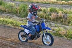 Young boy races motorcycle 1416.jpg Stock Photos