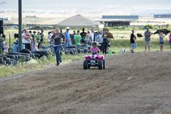 Young girl rides ATV while mother chases 1419.jpg - stock photo