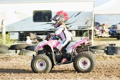 Young girl in pink rides ATV motorcycle race 1445.jpg Stock Photos