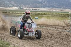 High speed ATV motorcycle on dirt track 1224.jpg - stock photo