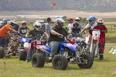 ATV motorcycle racers line up at start 1225.jpg Stock Photos