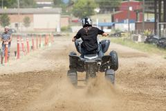 ATV motorcycle races down dirt drag strip 1240.jpg - stock photo