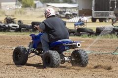 ATV motorcycle race man starts 1243.jpg - stock photo