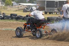 Fast speed ATV motorcycle races on dirt track 1244.jpg - stock photo